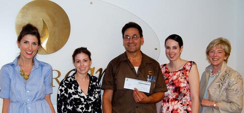 UPS representative Bobby Laperuta presenting a donation to CancerCare staff