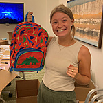 Photo of a CancerCare staff member holding a backpack